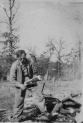 Benjamin Holt cutting wood